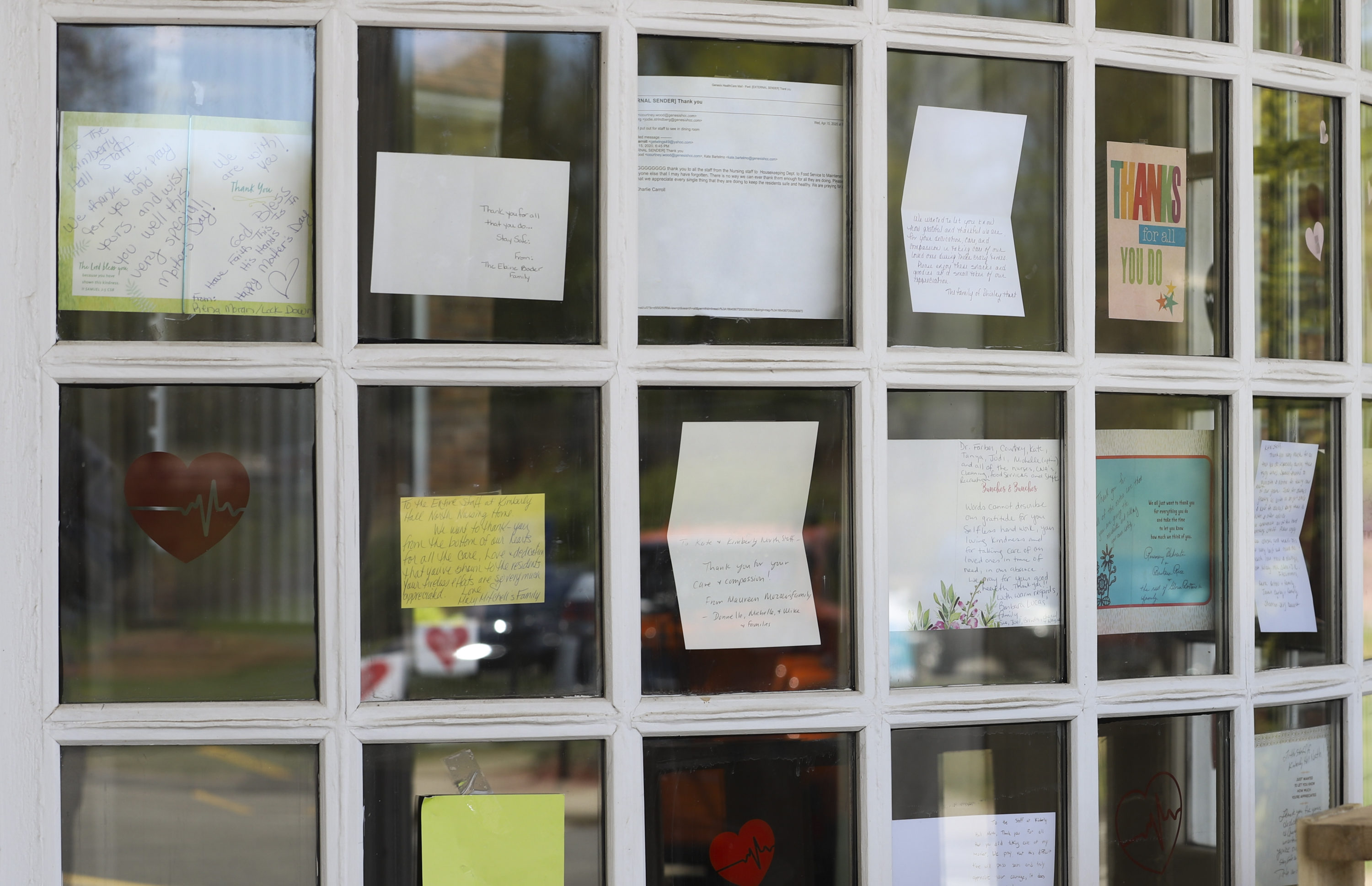 In this May 14, 2020 file photo, notes for healthcare workers hang in the front window at a Connecticut nursing home. (Chris Ehrmann/AP)
