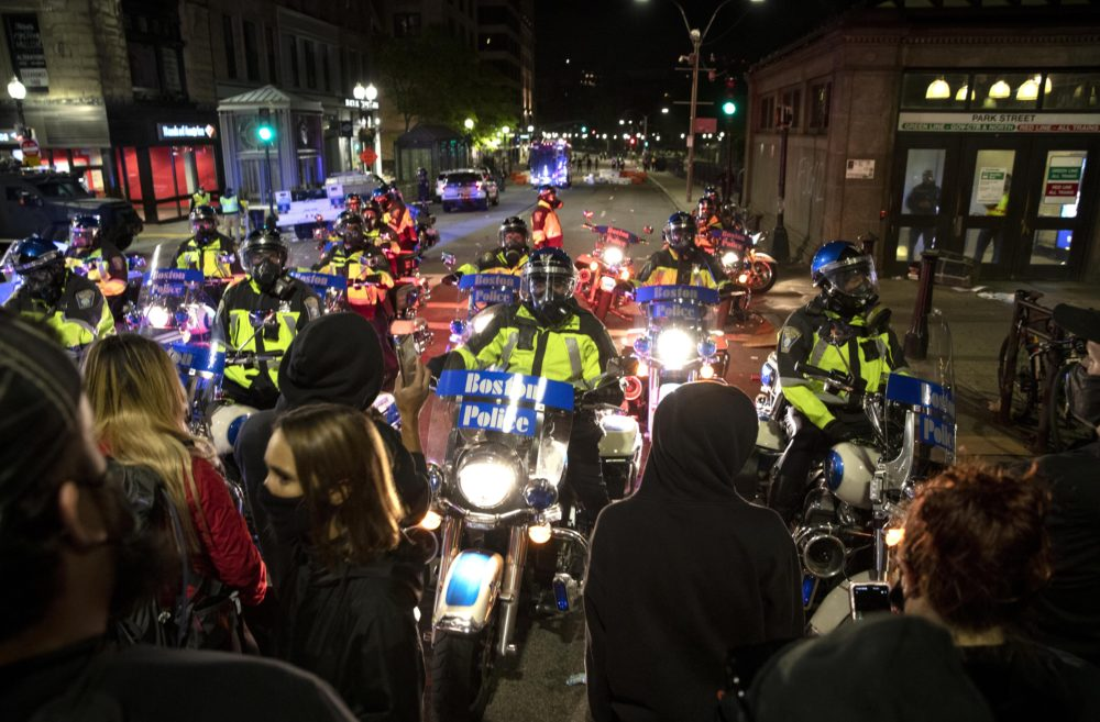 Police motorcycles block protestors way on Tremont Street during protests the evening of May 31, 2020. (Robin Lubbock/WBUR)