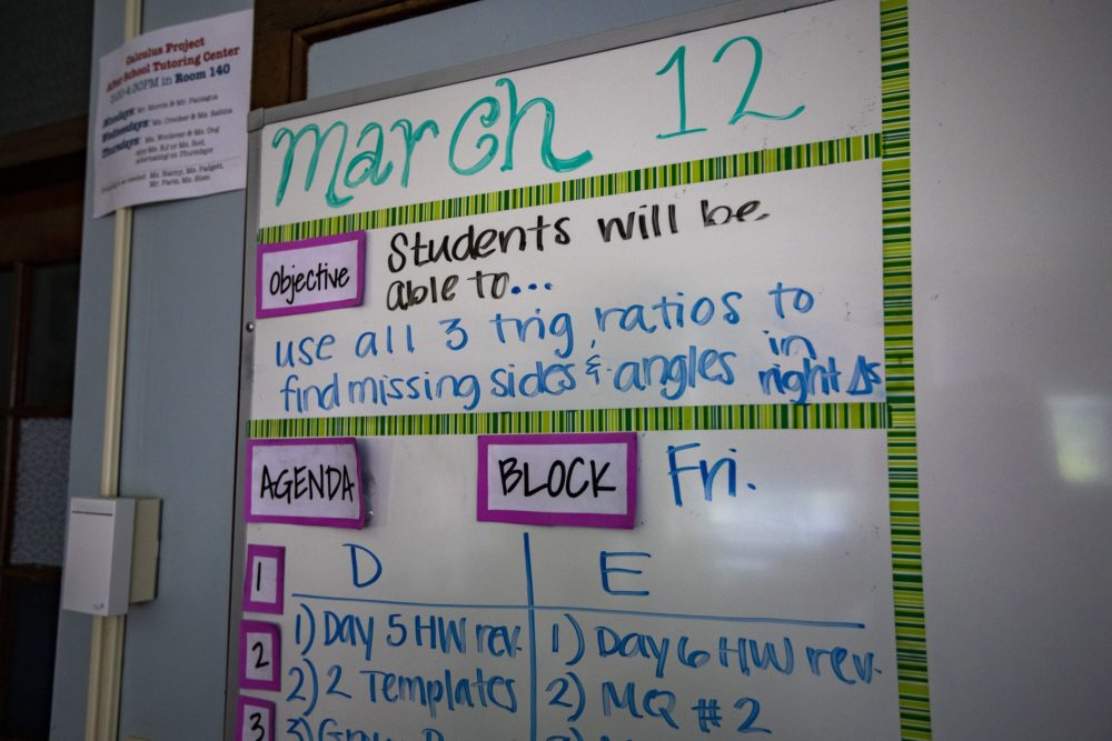 A whiteboard in a classroom at Old Lincoln School in Brookline with the day's assignments, dated for March 12, the last of school in Brookline before classes were suspended due to the pandemic. (Jesse Costa/WBUR)