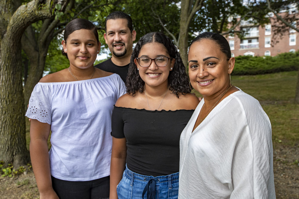 Jessica Armijo Sabillon, right, with her family at O'Malley State Park in Chelsea. (L-R) Daughter Michelle, 13, her husband Reymer and daughter Adriana, 17. (Jesse Costa/WBUR)