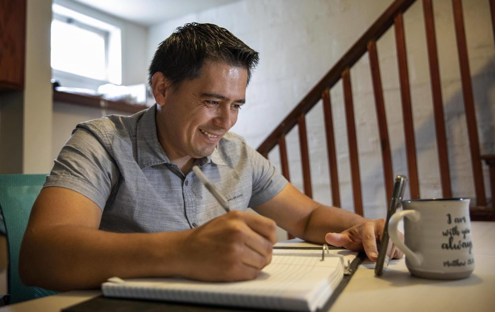From his basement in Lynn, Edwin Rivera attends ESOL classes online. Since the COVID-19 pandemic closed down his two restaurant jobs, he has been using his time to develop his English skills with the goal of becoming a medical interpreter. (Robin Lubbock/WBUR)