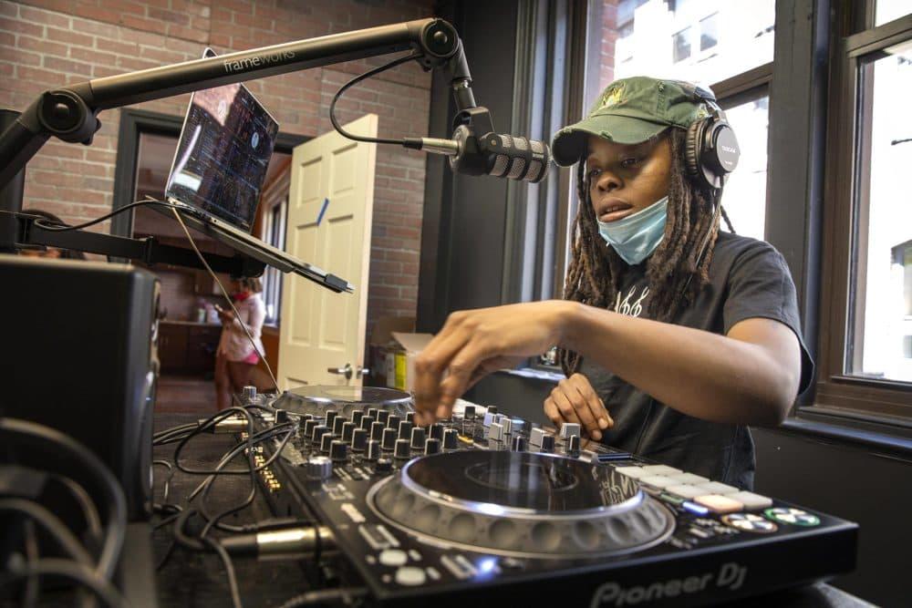 DJ WhySham, Shamara Rhodes, lines up some music for a show on Spark FM Online. (Robin Lubbock/WBUR)