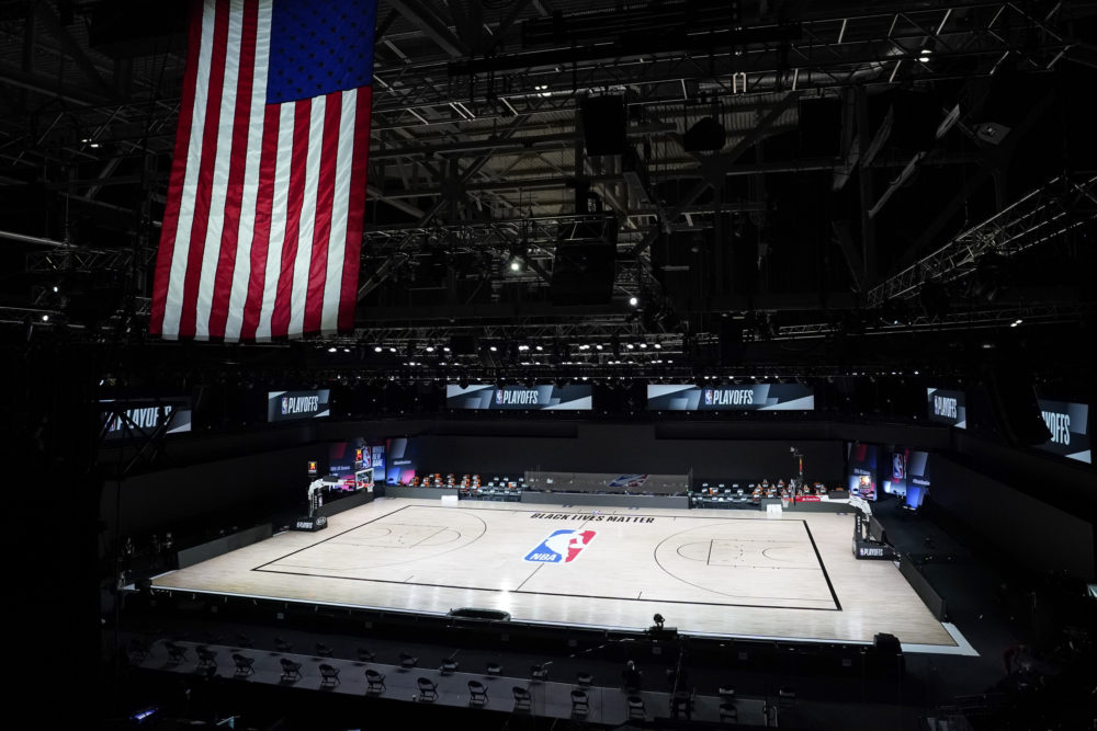 The court sits empty after the Milwaukee Bucks didn't take the floor in protest against racial injustice and the shooting of Jacob Blake, a Black man, by police in Kenosha, Wisconsin. (Ashley Landis/AP)