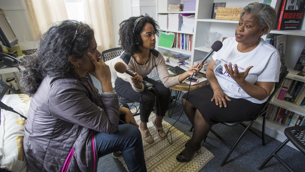 Host Meghna Chakrabarti and field producer Paris Alston speak with the Louis D. Brown Institute founder Tina Chéry. (Jesse Costa/WBUR).