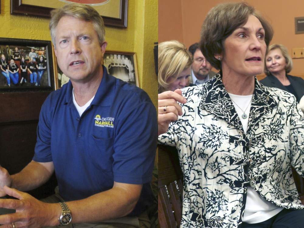 Rep. Roger Marshall and Kansas state Sen. Barbara Bollier. (John Hanna/AP)