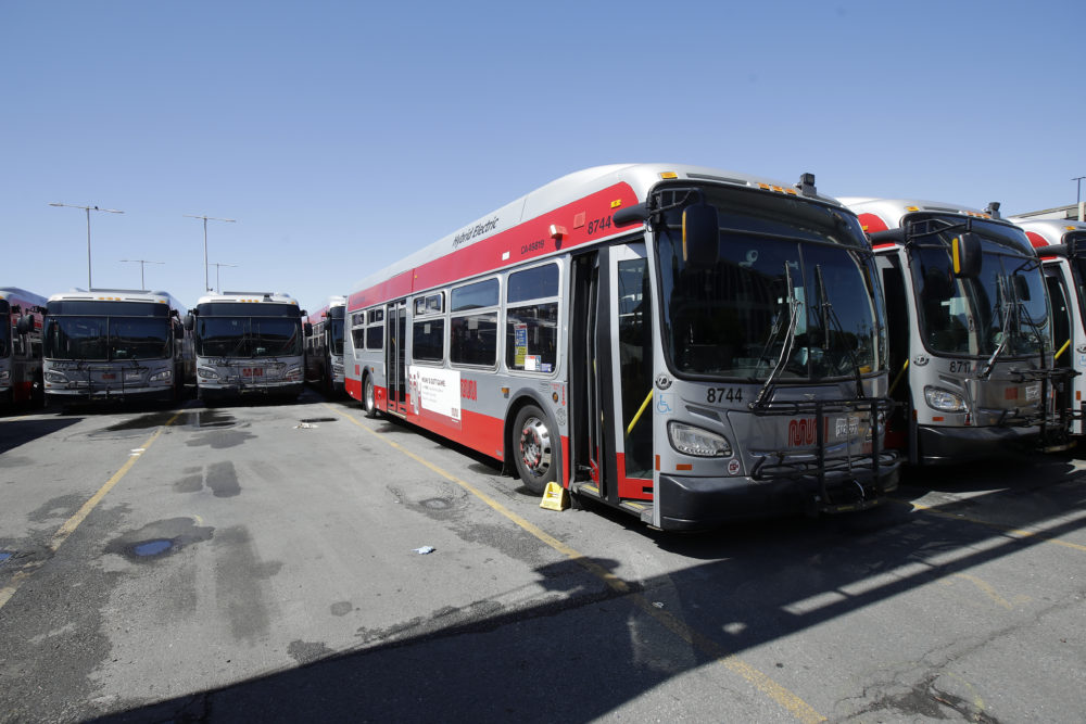 Muni buses are shown at a San Francisco Municipal Transportation Agency yard in San Francisco, Tuesday, April 7, 2020. (Jeff Chiu/AP)