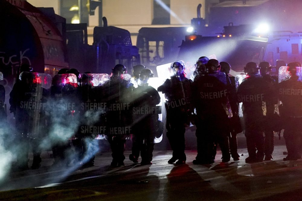 Authorities disperse protesters out of a park Tuesday, Aug. 25, 2020 in Kenosha, Wis. Anger over the Sunday shooting of Jacob Blake, a Black man, by police spilled into the streets for a third night. (Morry Gash/AP)