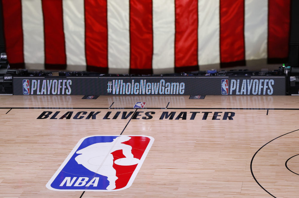 An empty court and bench are shown following the scheduled start time of Game 5 of an NBA basketball first-round playoff series, Wednesday, Aug. 26, 2020, in Lake Buena Vista, Fla. (Kevin C. Cox/Pool Photo via AP)