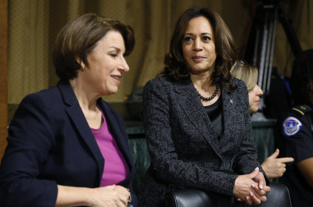 Senators Amy Klobuchar (left) and Kamala Harris talk before the Senate Judiciary Committee hearing with Christine Blasey Ford on Thursday, Sept. 27, 2018. (Michael Reynolds/Pool Image via AP)