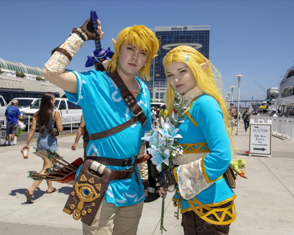 "Christian Capuccino, left, dressed as ""Link"" and Dayna Austin dressed as ""Zelda,"" pose on Day Two at Comic-Con International on Friday, July 19, 2019, in San Diego, Calif. (Photo by Christy Radecic/Invision/AP)"