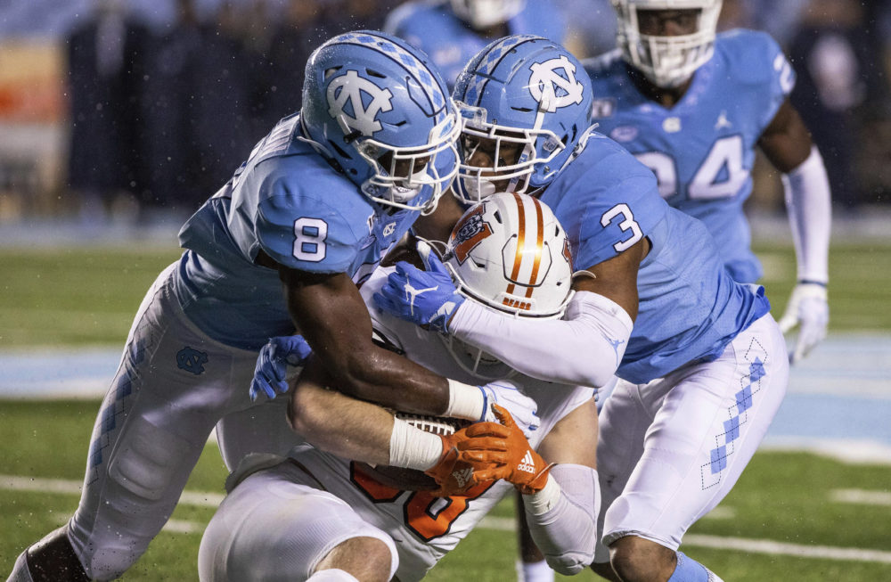 North Carolina's Khadry Jackson (8) and Dominique Ross (3) tackle Mercer's Chris Ellington (88) during the second half of an NCAA college football game in Chapel Hill, N.C., Saturday, Nov. 23, 2019. (Ben McKeown/AP)
