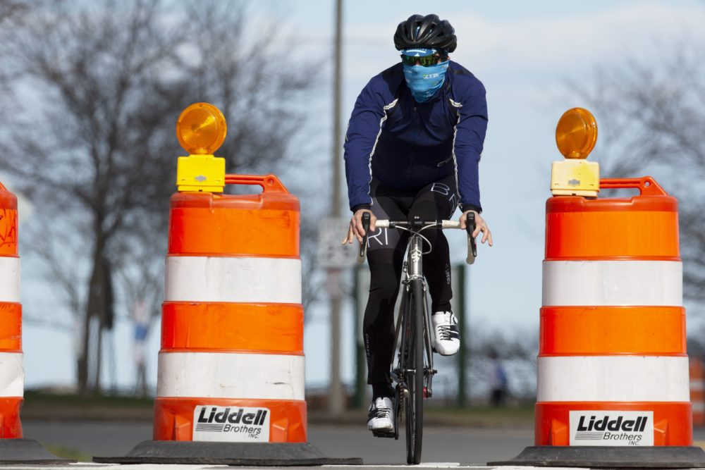 A cyclist rides down Day Boulevard in Boston, which was closed to traffic to allow pedestrians to socially distance, April 2020. (Michael Dwyer/AP)