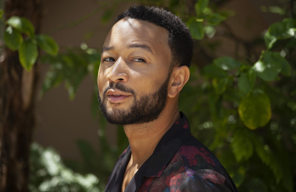 "Singer-songwriter John Legend appears during a photo session at The Bel Air Hotel in Beverly Hills, Calif., to promote his latest album ""Bigger Love."" (Rebecca Cabage/Invision/AP)"