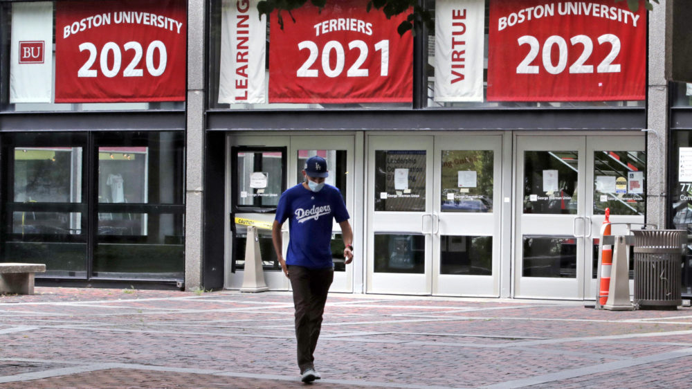 Weston Koenn, a graduate student from Los Angeles, leaves the Boston University student union building as he walks through the student-less campus in Boston on July 23, 2020. (Charles Krupa/AP)