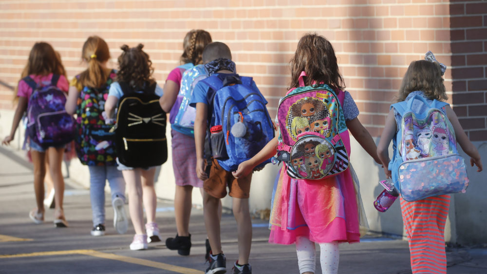 Students walk into Liberty Elementary School during the first day of class Monday, Aug. 17, 2020, in Murray, Utah. (Rick Bowmer/AP)
