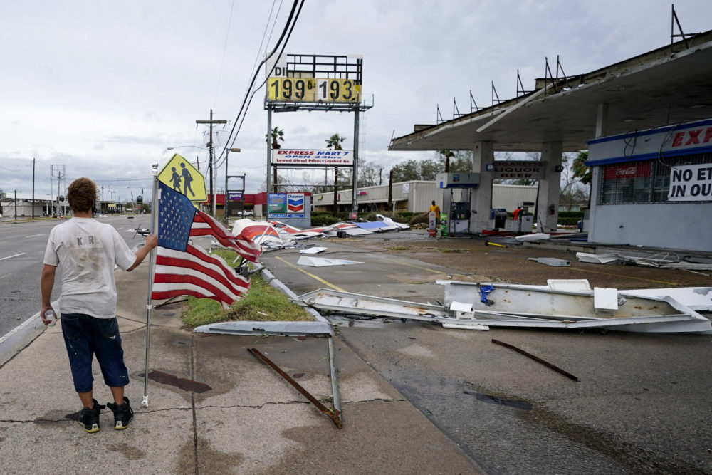 Dustin Amos walks near debris at a gas station on Thursday, Aug. 27, 2020, in Lake Charles, La., after Hurricane Laura moved through the state. (Gerald Herbert/AP)