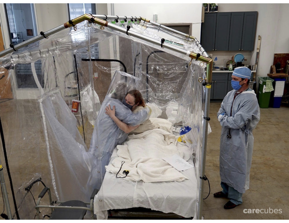 Hugging a patient using the Care Cube. (Courtesy of Toyota Research Institute and Otherlab)
