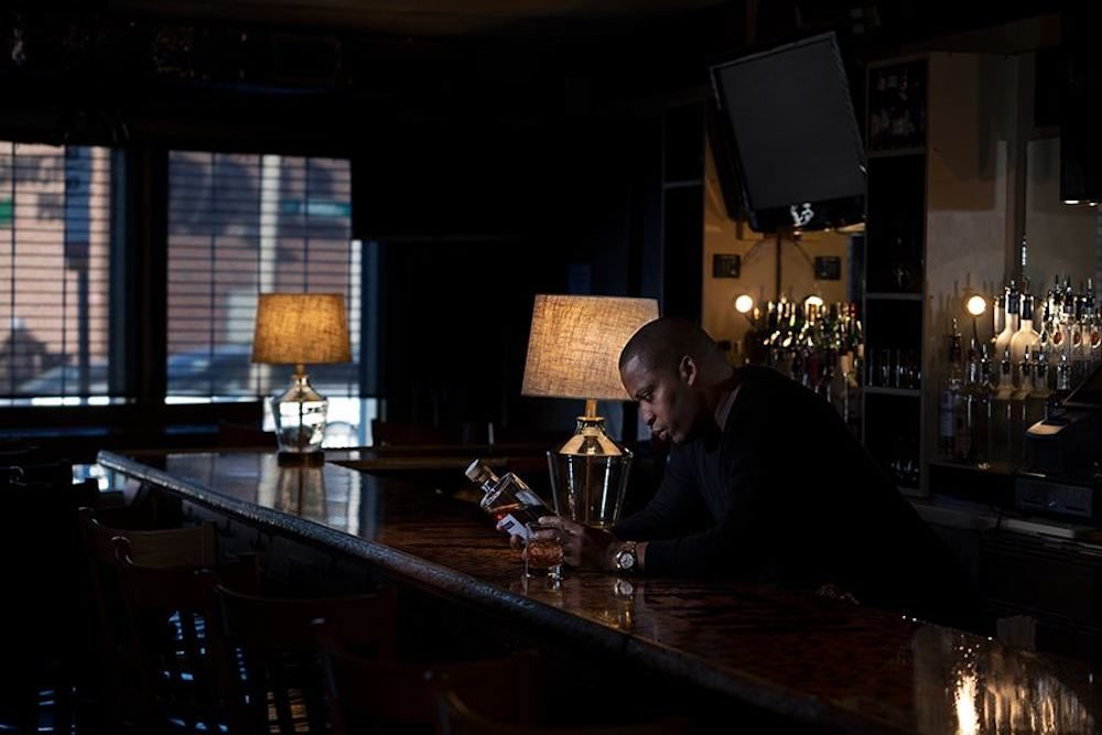 Royal C. Smith at his bar, District 7 Tavern, one of five restaurant owners that established the Boston Black Hospitality Coalition. (Courtesy Max Nagel Photography)