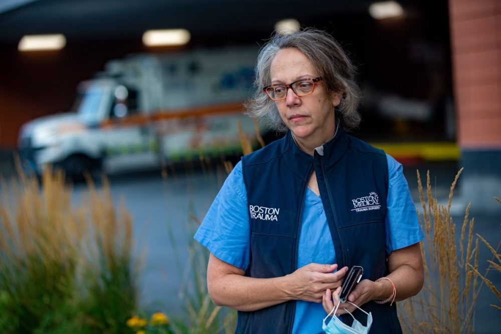 Trauma surgeon Dr. Tracey Dechert, who oversaw a COVID-19 intensive care unit during the pandemic surge, stands outside the emergency ambulance bay at Boston Medical Center. (Jesse Costa/WBUR)