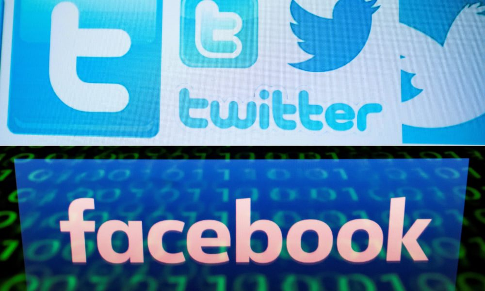 This combination of file pictures shows Twitter logos on a computer screen and the logo of social network Facebook. (Nicolas Asfouri,lionel Bonaventure/AFP via Getty Images)