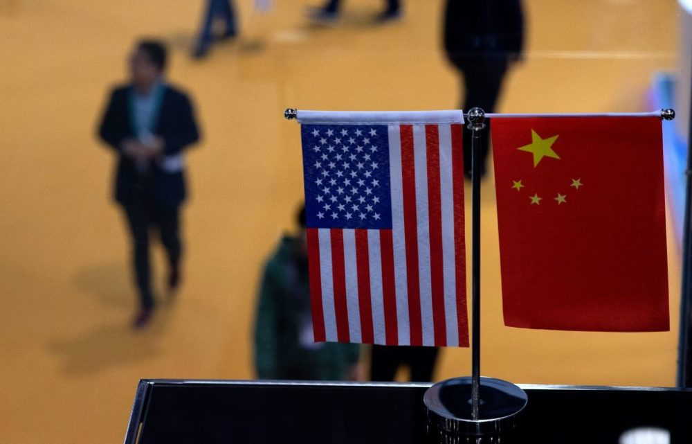 This picture taken on Nov. 6, 2018 shows a Chinese and U.S. flag at a booth during the first China International Import Expo in Shanghai. (Johannes Eisele/AFP/Getty Images)