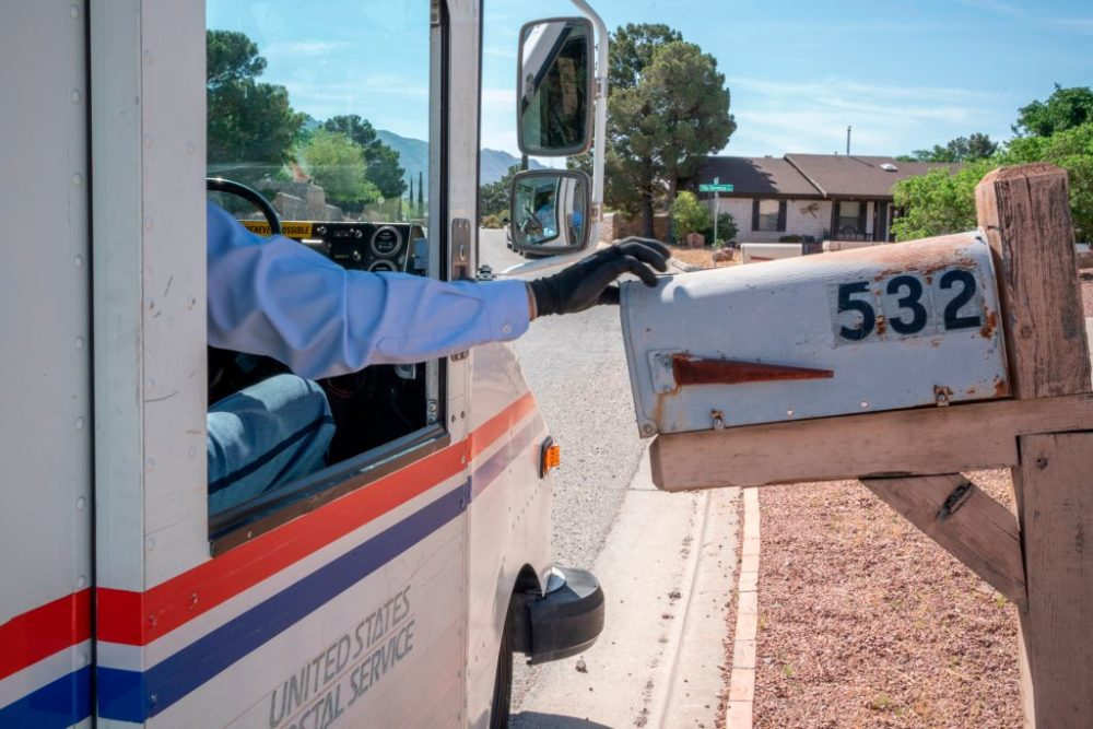 United States Postal Service mail carrier Frank Colon delivers mail amid the coronavirus pandemic in El Paso, Texas. (Paul Ratje/AFP/Getty Images)