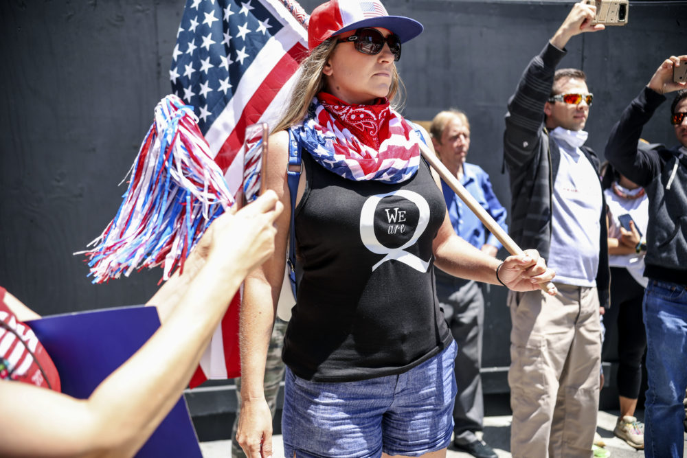 Conspiracy theorist QAnon demonstrators protest during a rally to re-open California and against Stay-At-Home directives on May 1, 2020 in San Diego, California. (Sandy Huffaker/AFP via Getty Images)