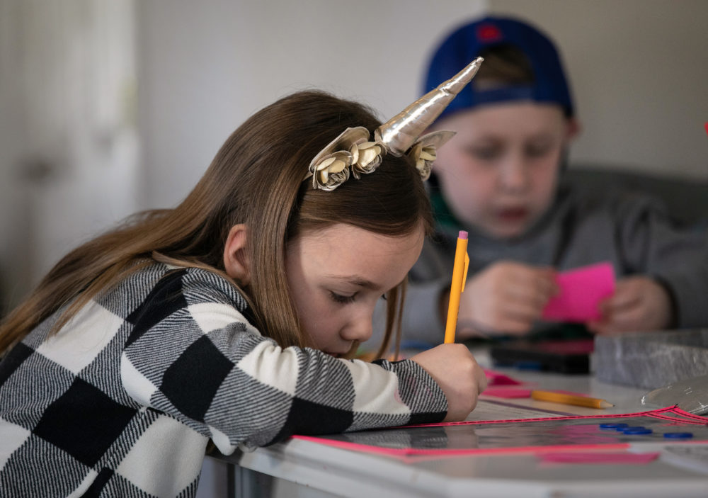 Nola Eaton, 6, and her brother Cam, 9, take part in home schooling on March 18, 2020 in New Rochelle, New York. (John Moore/Getty Images)
