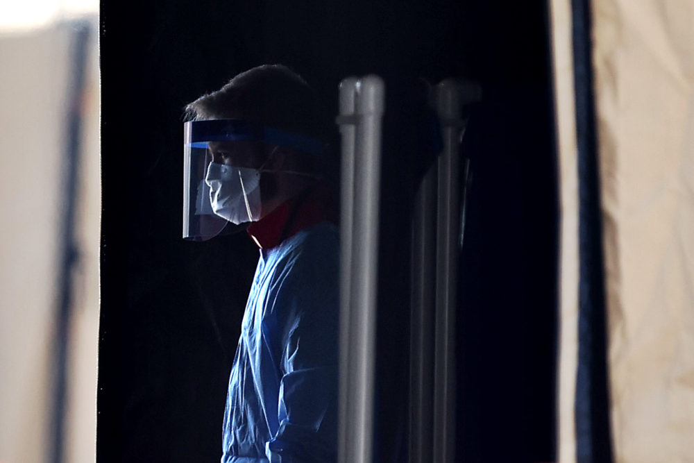 Healthcare professionals prepare to screen people for the coronavirus at a testing site (Chip Somodevilla/Getty Images)