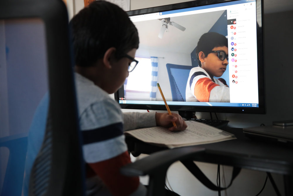 Parents are strategizing about how to teach their children at home as distance learning has become more of a norm during the pandemic. (Scott Olson/Getty Images)