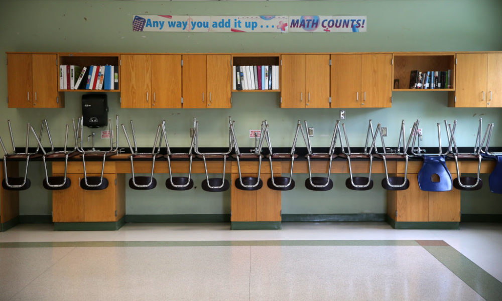 A finished clean room with stacked chairs in the science room at the Mildred Avenue K-8 School building in Boston's Mattapan. (Photo by David L. Ryan/The Boston Globe via Getty Images)