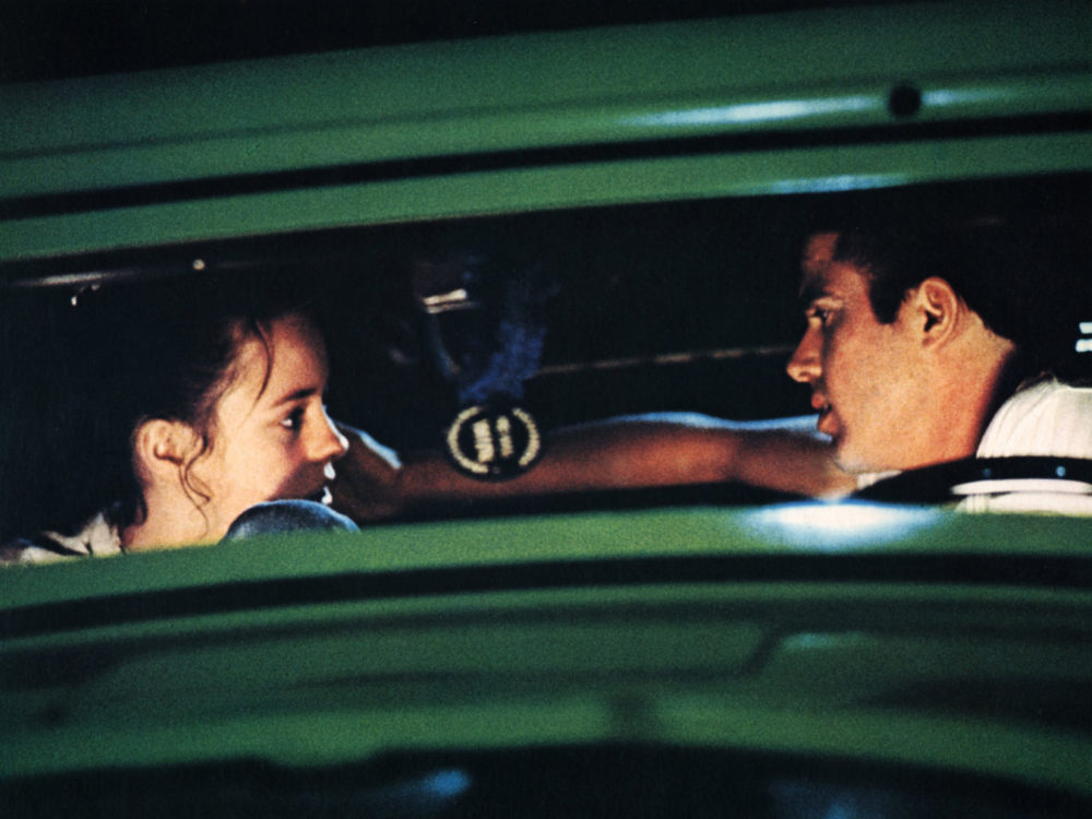 "Mackenzie Phillips and Paul LeMat in a scene from the 1973 George Lucas movie ""American Graffiti."" (Photo by FilmPublicityArchive/United Archives via Getty Images)"