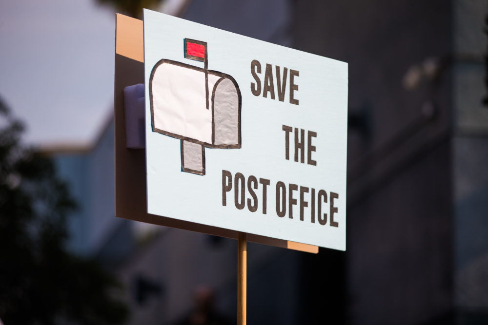Rally goers gather at a post office to protest the Trump administration's handling of the US Postal System at the Rally to Save the Post Office on August 22, 2020 in Los Angeles, California. (Rich Fury/Getty Images for MoveOn)