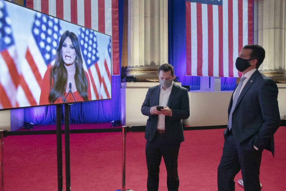 Donald Trump Jr. (R) watches his girlfriend Kimberly Guilfoyle as she pre-records her address to the Republican National Convention at the Mellon Auditorium on August 24, 2020 in Washington, DC. The COVID-19 pandemic has forced the Republican Party to move away from an in-person convention to a televised format, similar to the Democratic Party's convention a week earlier. (Chip Somodevilla/Getty Images)