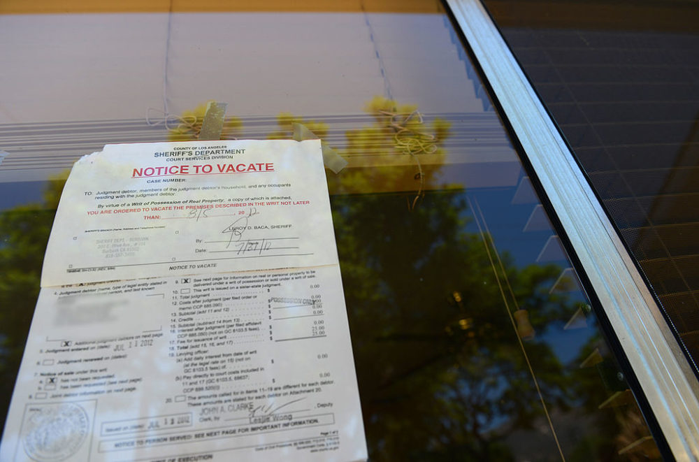 "A ""Notice to Vacate"" is seen in the window of a foreclosed home in Glendale, California, in 2012. (Robyn Beck/AFP/Getty Images)"