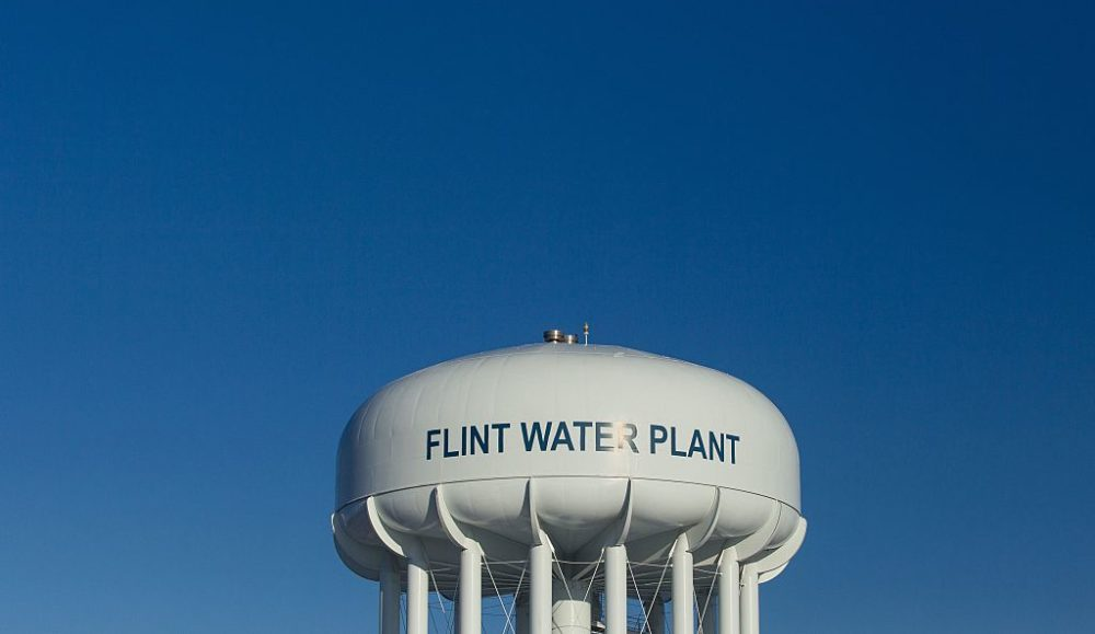 The water tower at the Flint Water Plant in Flint, Michigan, looms large over the city on March 4, 2016, nearly two years after the start of the city's water crisis. (Geoff Robins/AFP/Getty Images)