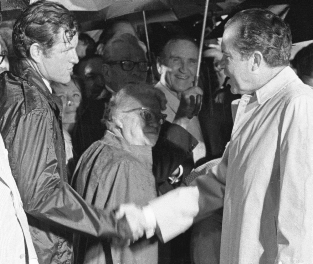 President Richard Nixon is greeted by Sen. Edward Kennedy, (D-Mass.), upon arrival at Andrews Air Force Base, August 3, 1969. (Getty Images)