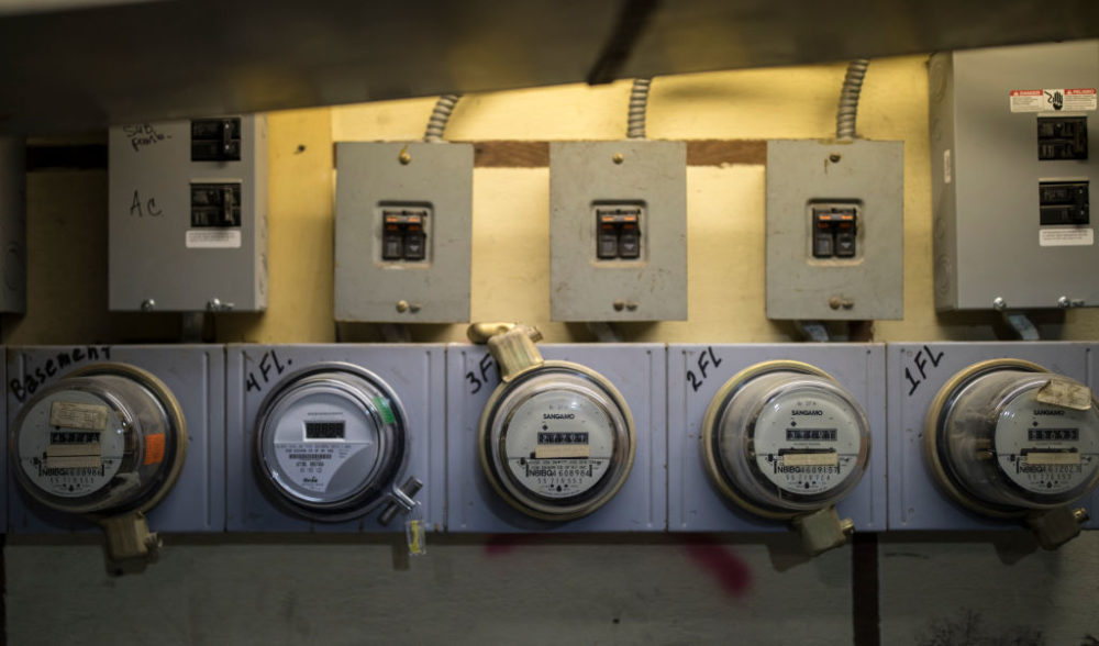 Five electricity meters measure power consumption in an apartment building in Brooklyn, New York. (Robert Nickelsberg/Getty Images)