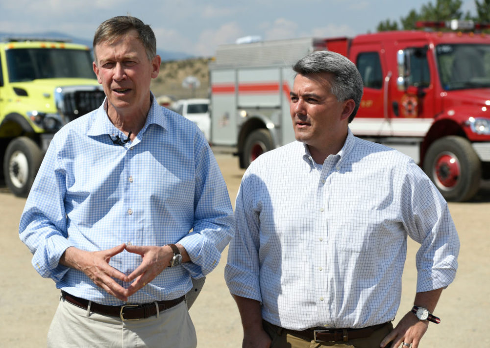 John Hickenlooper (left) and Cory Gardner discuss the Spring Fire during a press conference in 2018. (Andy Cross/The Denver Post via Getty Images)