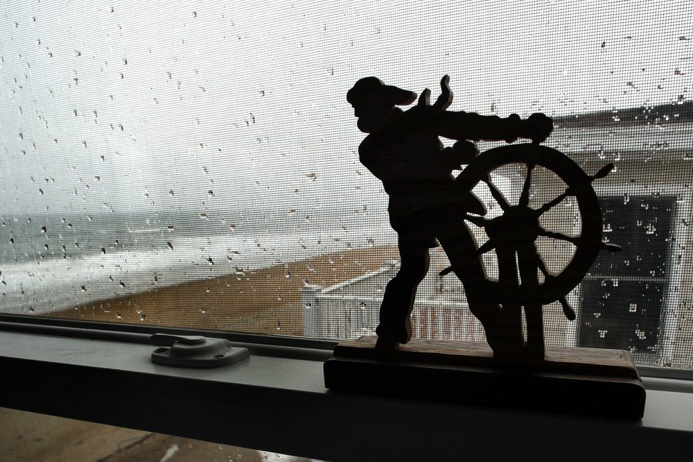 In this Feb. 15, 2019, file photo, the Atlantic Ocean surf washes up on the beach outside the window of an oceanfront condo in Salisbury, Massachusetts. (Elise Amendola/AP)