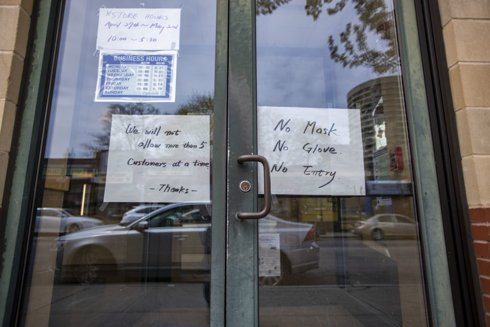 The list of restrictions on the door due to the coronavirus pandemic at Star Fish Market in Egelston Square. (Jesse Costa/WBUR)