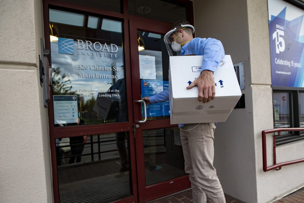 Jackson Stone, of Mpathy, delivers 45 covid testing samples from a nursing home in West Roxbury to the Broad Institute for analysis. (Jesse Costa/WBUR)