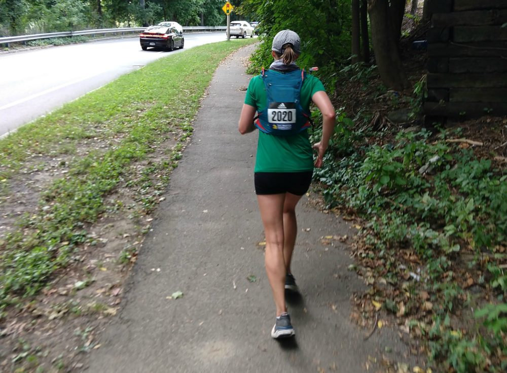 The author, Dianna Bell, running up a hill in Arlington during the last four miles of the virtual Boston Marathon, Sept. 13, 2020. (Courtesy Patrick Stanton)