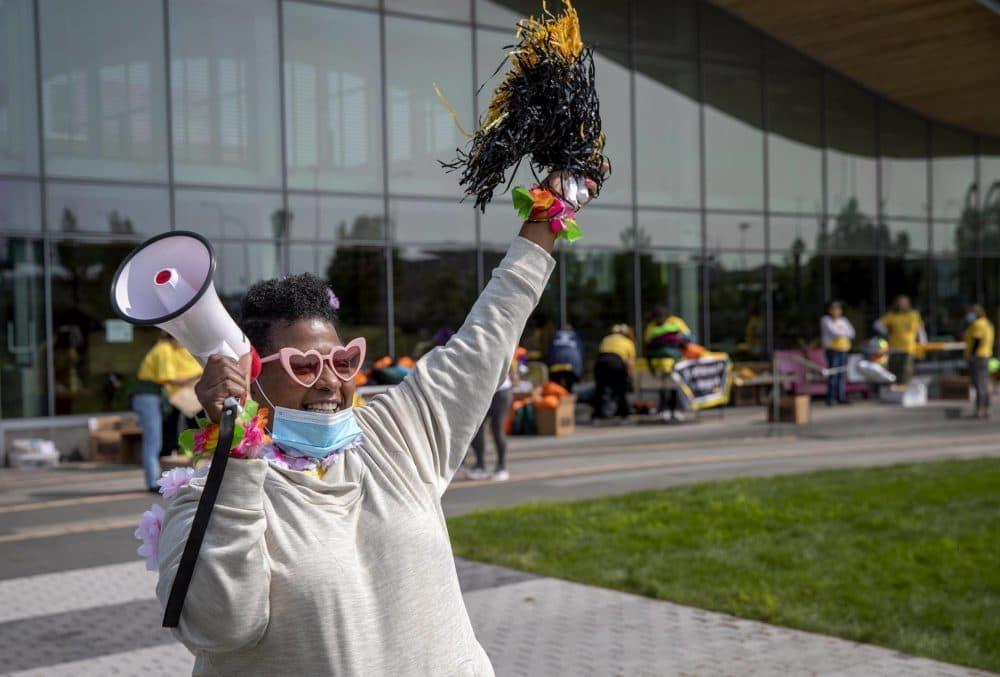 Program manager for the East Boston Countdown to Kindergarten Josette Williams welcomes families to the East Boston Public Library for the event. (Robin Lubbock/WBUR)