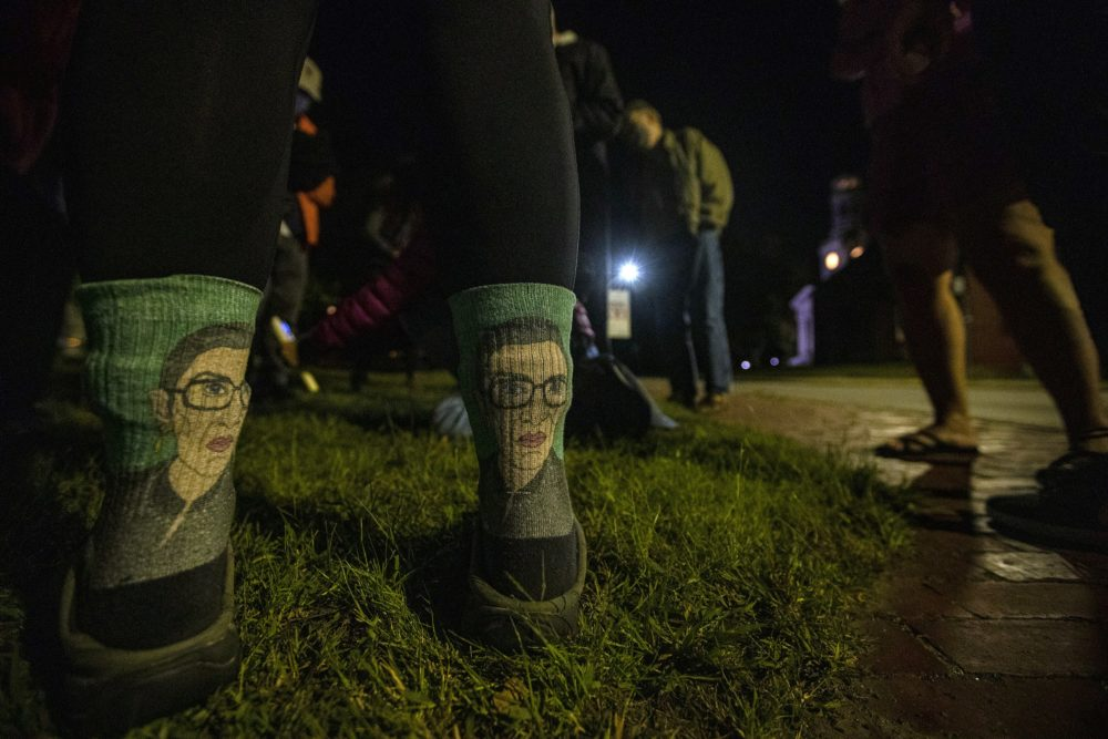 Kate Kavanaugh wore her Ruth Bader Ginsburg socks to to the vigil at Monument Square in Concord to pay respects after her death. (Jesse Costa/WBUR)