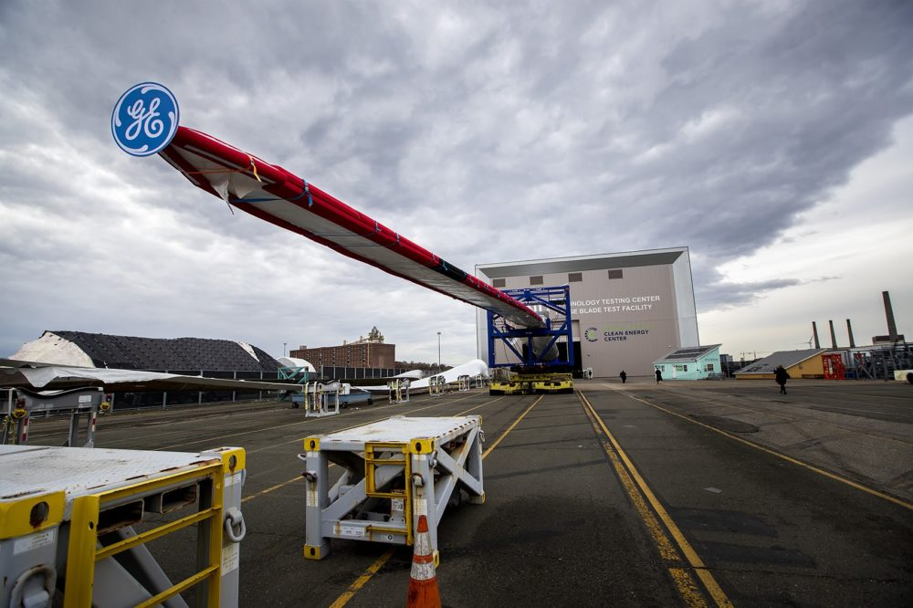 Massachusetts Clean Energy Center and GE unveil the Haliade-X 12MW offshore wind turbine blade at the Wind Technology Testing Center in Boston. (Jesse Costa/WBUR)
