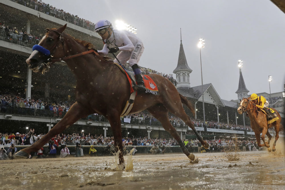 In this May 5, 2018, file photo, Mike Smith rides Justify to victory during the Kentucky Derby horse race in Louisville. The move of the Triple Crown's first leg to Labor Day weekend due to the coronavirus pandemic will mark the first time the Derby won't run on the first Saturday in May since 1945. (Morry Gash/AP)