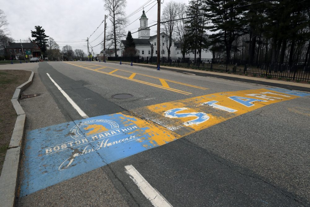 In this April 20, 2020 file photo, the Boston Marathon start line in Hopkinton, Mass., is vacant on the scheduled day of the 124th race, due to the COVID-19 virus outbreak. (Charles Krupa/AP)