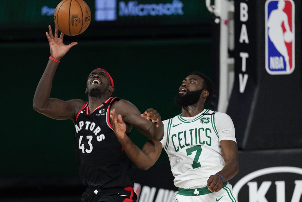 Toronto Raptors' Pascal Siakam catches a pass in front of Boston Celtics' Jaylen Brown during the second half of an NBA conference semifinal playoff basketball game Saturday, Sept. 5, 2020, in Lake Buena Vista, Florida. (Mark J. Terrill/AP)