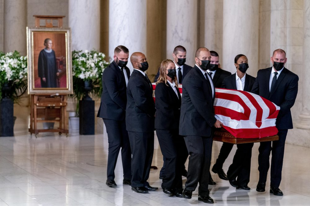 The flag-draped casket of Justice Ruth Bader Ginsburg, carried by Supreme Court police officers, arrived in the Great Hall at the Supreme Court in Washington Wednesday. Ginsburg, 87, died of cancer on Sept. 18. (Andrew Harnik/AP)